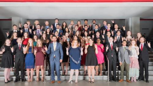 Group photo of NC State Goodnight Scholars class of 2019 and professional staff at the Goodnight Graduation Gala on April 2019 in Reynolds Coliseum.