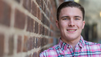 Photograph of NC State Transfer Goodnight Scholar Ethan Jenkins on NC State's main campus.