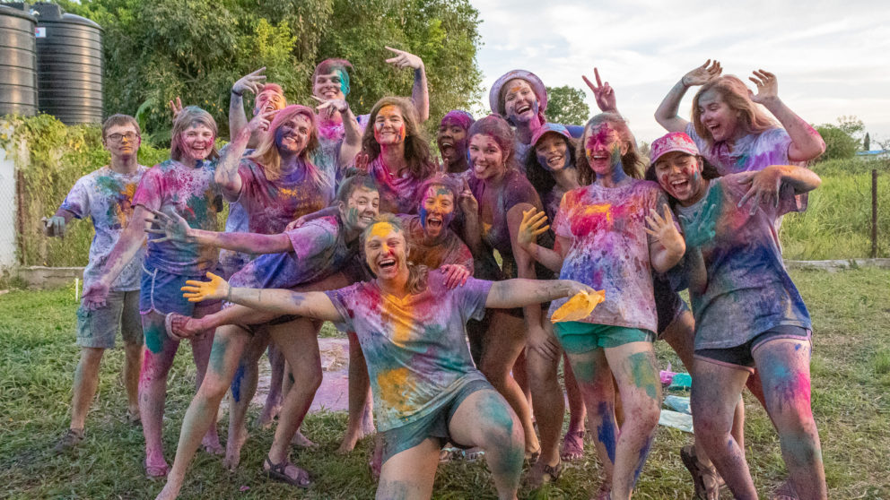 Group photos of NC State Goodnight Scholars participating in Holi during service trip to Trinidad & Tobago in March 2020.