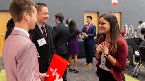 Photo of Goodnight Scholar Jessica Jones speaking with a finalist during the Finalist Interview Day at NC State's Centennial Campus.