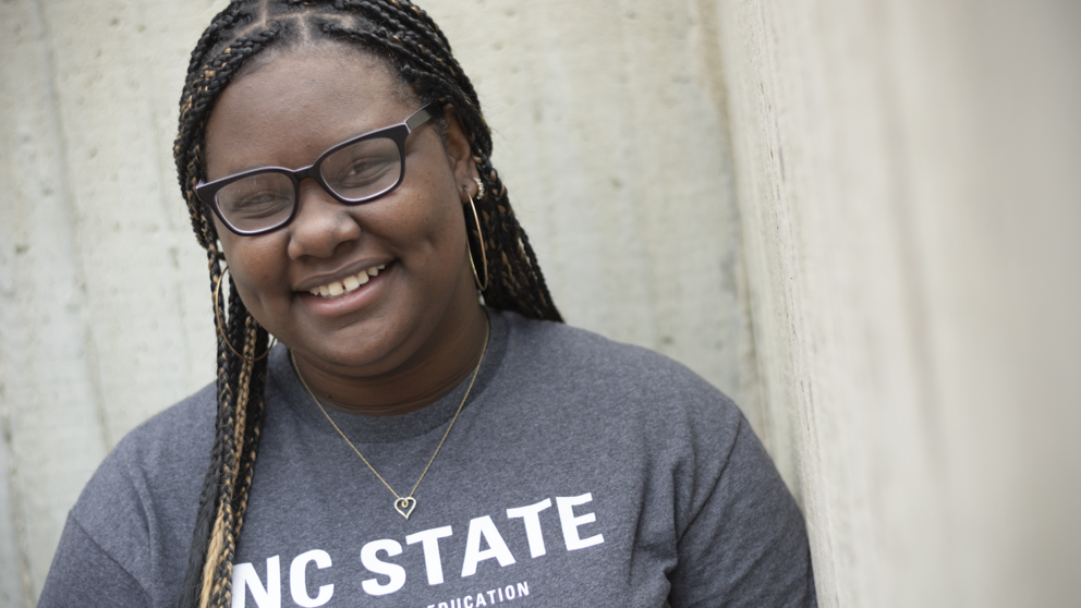 Photograph of NC State Goodnight Scholar Kyanna Sumpter of the class of 2022 in front of Poe Hall.