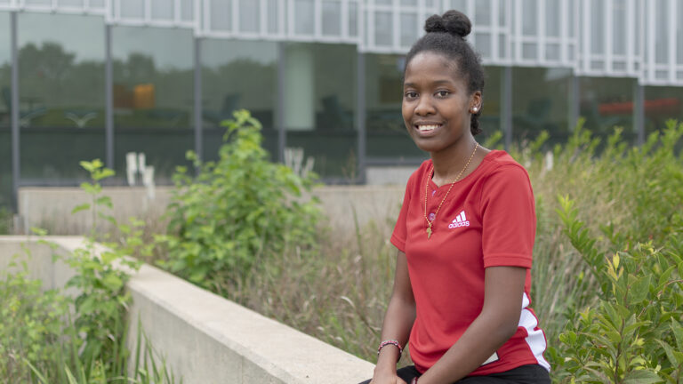 Photograph of Goodnight Scholar Ednah Sangaka from the transfer class of 2022 in front of Hunt Library on NC State Centennial Campus.
